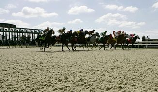 FILE - In this Oct. 6, 2006 file photo, the field breaks from the starting gate in the first race of Keeneland's fall meet in Lexington, Ky. When Keeneland's spring meet closes Friday, April 25, 2014, an era will end with it. It will mark the scenic track's last card using the synthetic Polytrack surface. (AP Photo/Ed Reinke, File)
