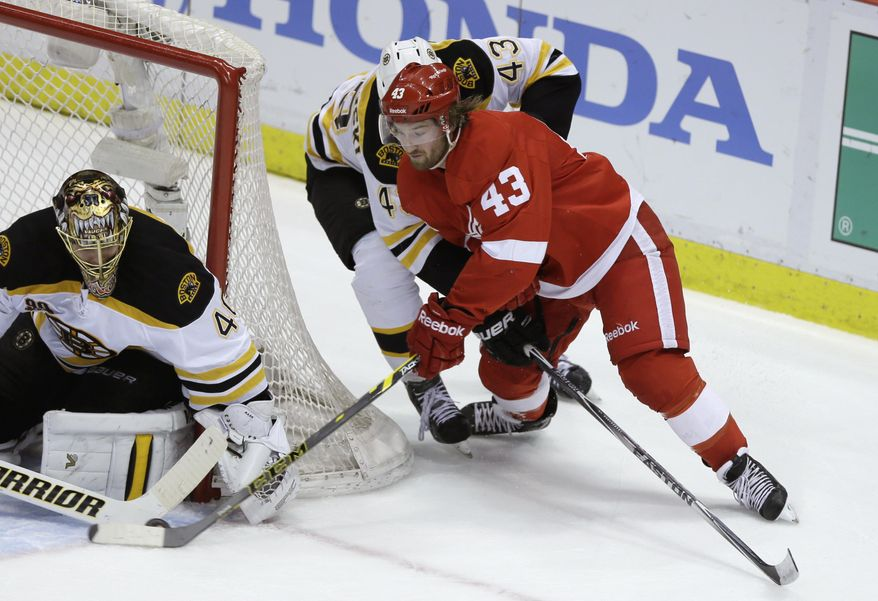 Boston Bruins goalie Tuukka Rask (40) of Finland stops a shot by Detroit Red Wings center Darren Helm (43) during the second period of Game 4 of a first-round NHL hockey playoff series in Detroit, Thursday, April 24, 2014. (AP Photo/Carlos Osorio)