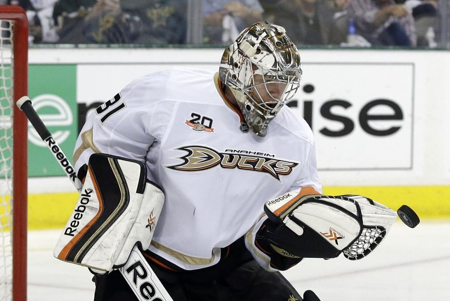 Anaheim Ducks' Frederik Andersen (31) of Denmark attempts to glove a shot by the Dallas Stars in the first period of Game 4 of a first-round NHL hockey Stanley Cup playoff series, Wednesday, April 23, 2014, in Dallas. (AP Photo/Tony Gutierrez)