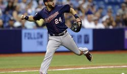 Minnesota Twins third baseman Trevor Plouffe overruns a bunt by Tampa Bay Rays' Ben Zobrist hit off Twins relief pitcher Caleb Thielbar during the seventh inning of a baseball game on Thursday, April 24, 2014, in St. Petersburg, Fla. Zobrist was safe at first base. (AP Photo/Chris O'Meara)