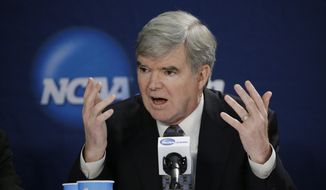 FILE - In this April 6, 2014 file photo, NCAA President Mark Emmert answers a question at a news conference in Arlington, Texas. The NCAA's board of directors is scheduled to discuss and endorse a 57-page overhaul plan that would hand far more power to five major conferences to decide how to treat and perhaps satisfy their athletes.(AP Photo/David J. Phillip, File)