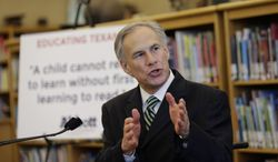 File - In this April 2, 2014 file photo, Attorney General and Republican gubernatorial candidate Greg Abbott talks about his early education plan during a stop at the IDEA Carver Academy in San Antonio. A Texas land dispute has Perry and the Republican candidate favored to replace him, Greg Abbott, decrying the same federal agency currently embroiled in an armed standoff in Nevada. (AP Photo/Eric Gay, File)