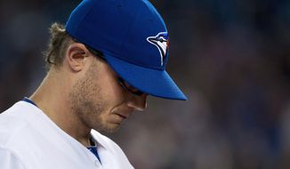 Toronto Blue Jays pitcher Brett Cecil, looks down as he walks back to the dugout after allowing two runs to the Baltimore Orioles during the seventh inning of a baseball game in Toronto on Thursday, April 24, 2014. (AP Photo/The Canadian Press, Nathan Denette)