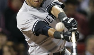 New York Yankees' Yangervis Solarte connects for a two-RBI single during the seventh inning of a baseball game against the Boston Red Sox, Thursday, April 24, 2014, in Boston. (AP Photo/Charles Krupa)