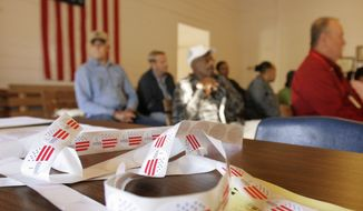 Voters gather in a nearly century-old school house, now a community center, being used as a polling place near Arkadelphia, Ark., Tuesday, Nov. 4, 2008. (AP Photo/Danny Johnston)