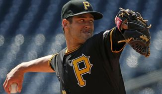 Pittsburgh Pirates starting pitcher Brandon Cumpton (58) delivers during the first inning of a baseball game against the Cincinnati Reds in Pittsburgh Thursday, April 24, 2014. (AP Photo/Gene J. Puskar)