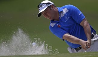 Andrew Svoboda hits out of the sand onto the 18th green during the opening round of the Zurich Classic golf tournament at TPC Louisiana in Avondale, La., Thursday, April 24, 2014.  (AP Photo/Gerald Herbert)