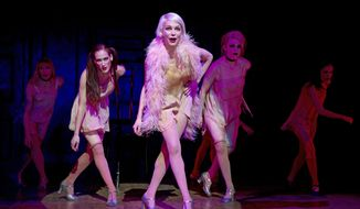 """This undated image released by Polk & Co. shows Michelle Williams, center, during a performance in """"Cabaret,"""" at Studio 54 in New York. (AP Photo/Polk & Co., Joan Marcus)"""