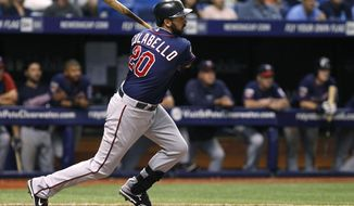 Minnesota Twins' Chris Colabello follows through on his two-run single to score teammates Joe Mauer and Trevor Plouffe during the top of the 12th inning of a baseball game against the Tampa Bay Rays on Wednesday, April 23, 2014, in St. Petersburg, Fla. (AP Photo/Brian Blanco)