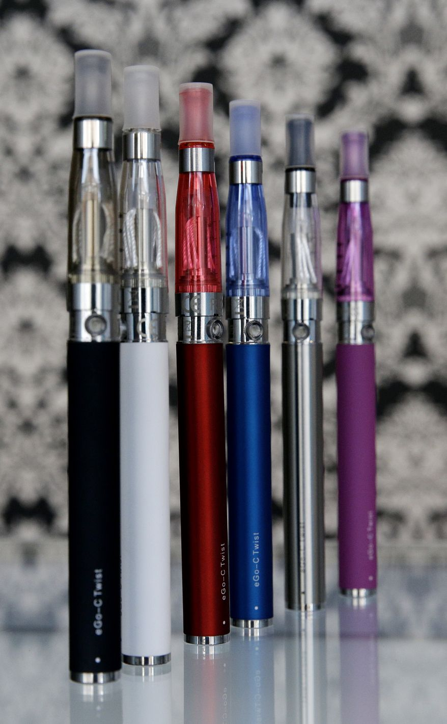 E-cigarettes appear on display at Vape store in Chicago, Wednesday, April 23, 2014. The federal government wants to ban sales of electronic cigarettes to minors and require approval for new products and health warning labels under regulations being proposed by the Food and Drug Administration. (AP Photo/Nam Y. Huh)