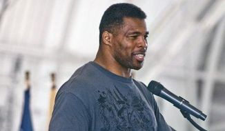 Former NFL football player Herschel Walker speaks to airmen Thursday, March 22, 2012, at Eglin Air Force Base, Fla. (Associated Press) ** FILE **