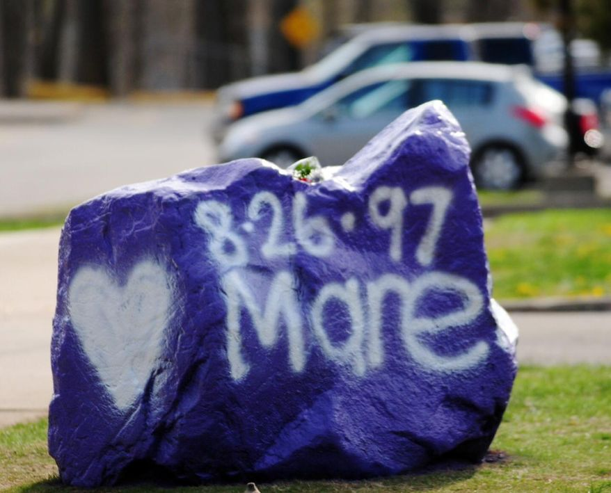 A rock spray-painted by students sits in memory of 16-year-old stabbing victim Maren Sanchez on Friday, April 25, 2014, sits outside Jonathan Law High School in Milford, Conn. Sanchez was stabbed to death earlier during an altercation inside the school. A teenage boy is in custody, and police are investigating whether she was stabbed because she declined to be his date at the junior prom. (AP Photo/The New Haven Register, Peter Hvizdak) MANDATORY CREDIT