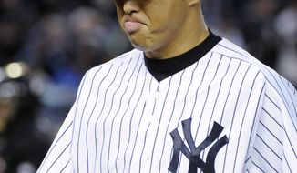 New York Yankees pitcher Hiroki Kuroda reacts as he walks off the the field after allowing three runs in the second inning of a baseball game against the Los Angeles Angels, Friday, April 25, 2014, at Yankee Stadium in New York. (AP Photo/Bill Kostroun)