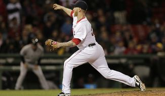 Boston Red Sox's Mike Carp delivers a pitch during the ninth inning of a baseball game against the New York Yankees, Thursday, April 24, 2014, in Boston. (AP Photo/Charles Krupa)