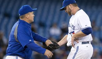 Toronto Blue Jays manager John Gibbons pulls starting pitcher Mark Buehrle during the sixth inning of a baseball game against the Boston Red Sox in Toronto on Friday, April 25, 2014. Boston won 8-1. (AP Photo/The Canadian Press, Frank Gunn)