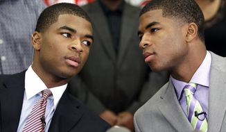FILE - In this Oct. 4, 2012 file photo, wwins Aaron, left, and Andrew Harrison, right, talk before announcing they will attend and play NCAA college basketball for Kentucky, in Richmond, Texas. The twins will return for a second season to a stocked Wildcats squad coming off an NCAA championship appearance. (AP Photo/David J. Phillip, File)
