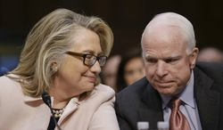 FILE - In this Jan. 24, 2013, file photo, then-Secretary of State Hillary Rodham Clinton huddles with Sen. John McCain, R-Ariz., on Capitol Hill in Washington. McCain and Clinton share a friendship forged in the Senate, on fact-finding trips around the globe and over vodka shots in Estonia. He's a former Republican presidential nominee. She could be the next Democratic presidential nominee. And lately, the Clintons and McCains seem to have embraced each other, offering up their families' working relationship as an example of wlkays political leaders can overcome the partisan divide. (AP Photo/J. Scott Applewhite, File)