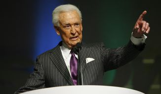 "FILE - This April 14, 2008 file photo shows Bob Barker speaking as he is inducted into National Association of Broadcasters hall of fame in Las Vegas. Barker, whose love of animals is returning him to TV on Wednesday, April 30, 2014, as a guest star on ""The Bold and the Beautiful."" Appearing as himself, the long-time animal rights activist will be interviewed by Liam Spencer, played by series regular Scott Clifton, for a feature article on control of the pet population. (AP Photo/Isaac Brekken, File)"