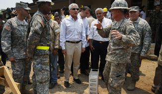 Defense Secretary Chuck Hagel and Guatemalan President Otto Perez Molina visit the Beyond the Horizons site in Los Limones, Guatemala, Friday, April 25, 2014.    (AP Photo/Shannon Stapleton, Pool)