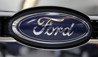 FILE - This file photo taken on Feb. 14, 2013 shows the Ford logo on the grill of a 2013 Ford F-350 truck on display at the Pittsburgh Auto Show in Pittsburgh. Ford reports quarterly earnings on Friday, April 25, 2014. (AP Photo/Gene J. Puskar, File)