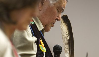 Clyde Bellecourt, also known as Thunder Before the Storm, holds a condor feather while praying before the Minneapolis City Council unanimously voted  on Friday, April 25, 2014, in Minneapolis, to recognize Columbus Day as Indigenous Peoples Day. (AP Photo/Star Tribune, Courtney Perry)  MANDATORY CREDIT; ST. PAUL PIONEER PRESS OUT; MAGS OUT; TWIN CITIES TV OUT
