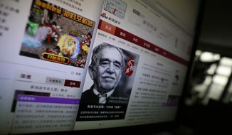 "A purple dialog box announces the temporary closure of the literature site as it undergoes ""a self-correction action"" on the Chinese web giant Sina.com books site displayed on a computer in Beijing, China, Friday, April 25, 2014. Chinese web giant Sina.com temporarily closed its literature site Friday after reports it would lose two crucial publication licenses for hosting pornography. Sina decided to take books off its site while it undergoes ""a self-correction action"" to screen their content, according to a notice on its reading channel. Book reviews, cultural news, author biographies and interviews were still available.(AP Photo/Ng Han Guan)"