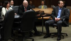 Theodore Wafer, right, listens during a motion hearing in Judge Timothy Kenny's courtroom at the Frank Murphy Hall of Justice in Detroit, Friday, April 25, 2014. Wafer has been accused of fatal shooting 19-year-old Renisha McBride on the porch of his home. Kenny removed Judge Qiana Lillard on Friday from the case of Wafer. Defense attorneys argued Lillard's previous employment with the prosecutor's office and associations with employees created an appearance of impropriety. (AP Photo/Detroit Free Press, Eric Seals)  DETROIT NEWS OUT;  NO SALES