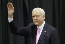 Sen. Orrin Hatch, R-Utah, waves before addressing a crowd during the Western Republican Leadership Conference, Friday, April 25, 2014, in Sandy, Utah. Republican U.S. Sen. Ted Cruz, of Texas, is scheduled to headline the final day of a two-day conference in Utah where Republican party leaders from western states are meeting. (AP Photo/Rick Bowmer)