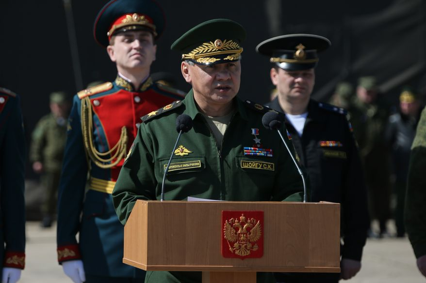 In this photo provided by the Russian Defense Ministry, Russian Defense Minister Sergei Shoigu, foreground, addresses Russian troops billeted in the Crimea at a military base in Sevastopol, Crimea, Monday, March 24, 2014. Shoigu's visit comes as Ukraine's fledgling government on Monday ordered Ukrainian troops to withdraw from Crimea, ending days of wavering as Russian troops consolidate control over the peninsula. (AP photo/Press Service of Russian Defense Ministry, Vadim Savitsky)