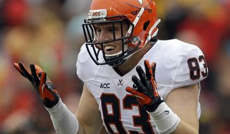 Virginia tight end Jake McGee reacts after scoring a touchdown in the first half of an NCAA college football game against Maryland in College Park, Md., Saturday, Oct. 12, 2013. (AP Photo/Patrick Semansky)