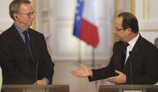 **FILE** Google CEO Eric Schmidt (left) and French President Francois Hollande attend a news conference at the Elysee Palace in Paris after signing an agreement in Paris on Feb. 1, 2013. Google will help French news organizations increase their online advertising revenue and also set up a euros 60 million ($82 million) fund to finance digital publishing innovation, settling a dispute over whether the Internet giant should pay to display news content in its search results. (Associated Press)