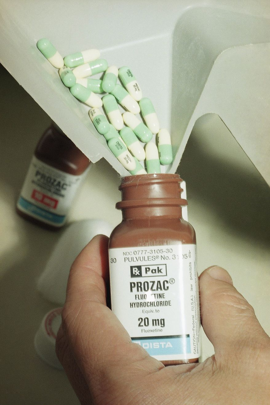**FILE** A pharmacists pours Prozac capsules into its container in Los Angeles on Jan. 23, 1997. (Associated Press)