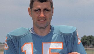 FILE - This is a 1972 file photo showing Miami Dolphins quarterback Earl Morrall. Morrall, an NFL quarterback for 21 years who started nine games during the Miami Dolphins' perfect season in 1972, has died at age 79. The Dolphins confirmed Morrall's death Friday, April 25, 2014.  (AP Photo/File)