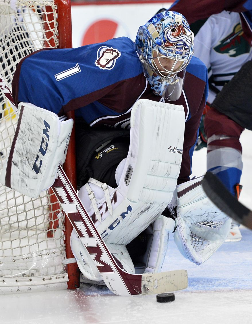 Colorado Avalanche goalie Semyon Varlamov (1) from Russia makes a save against the Minnesota Wild in the second period of Game 2 of an NHL hockey first-round playoff series on Saturday, April 19, 2014, in Denver. (AP Photo/Jack Dempsey)