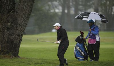 Carlota Ciganda, of Spain, follows her shot from just off the first fairway of the Lake Merced Golf Club during the second round of the Swinging Skirts LPGA Classic golf tournament Friday, April 25, 2014, in Daly City, Calif. (AP Photo/Eric Risberg)