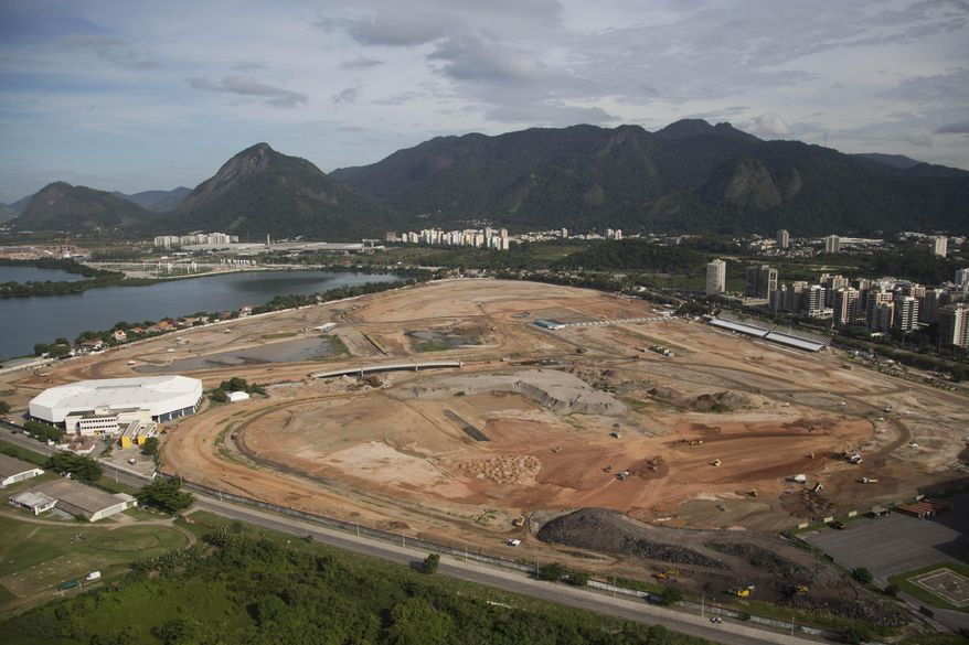 FILE- In this April 11, 2013 file photo, the Olympic Park, that will host competitions for 10 sports at Rio's Olympics in 2016, is under construction in the area previously occupied by the Jacarepagua Autodrome in Rio de Janeiro, Brazil. Rio de Janeiro's mayor Eduardo Paes says he expects federations to continue complaining about the city's preparations until the start of the games, but that he will not bow to their pressure and will keep his focus on securing a legacy for Rio well beyond Olympics. (AP Photo/Felipe Dana, File)