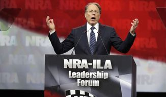 National Rifle Association (NRA) Executive Vice President and Chief Executive Officer Wayne LaPierre speaks during the leadership forum at the National Rifle Association's annual convention, Friday, April 25, 2014, in Indianapolis. Several potential Republican contenders for president planned on courting gun-rights supporters at the NRA's annual convention Friday. (AP Photo/AJ Mast)