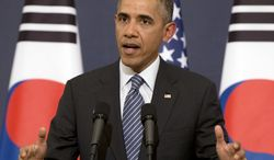 U.S. President Barack Obama gestures as he speaks during a joint news conference with South Korean President Park Geun-hye at the Blue House, Friday, April 25, 2014, in Seoul, South Korea. The U.S. and Europe are laying the groundwork to sanction broad sections of Russia's economy if Moscow invades eastern Ukraine, Obama said Friday, even as he acknowledged those sanctions may fail to deter Vladimir Putin. (AP Photo/Carolyn Kaster)