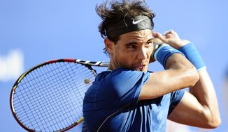 Rafael Nadal returns the ball to Nicolas Almagro during the Barcelona open tennis in Barcelona, Spain, Friday, April 25, 2014. (AP Photo/Manu Fernandez)