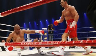IBF, WBA, WBO and IBO champion Wladimir Klitschko from Ukraine, right, knocks down his Australian challenger Alex Leapai during their heavyweight world title bout in Oberhausen, western Germany, Saturday, April 26, 2014. (AP Photo/Frank Augstein)