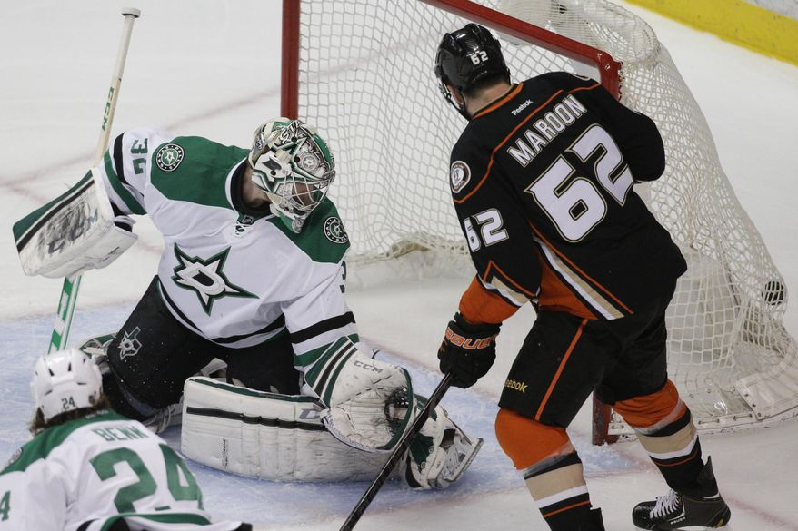 Dallas Stars goalie Kari Lehtonen, left, of Finland, and Anaheim Ducks' Patrick Maroon watch the puck hit by Anaheim Ducks' Nick Bonino enters the net during the first period of Game 5 of the first-round NHL hockey Stanley Cup playoff series on Friday, April 25, 2014, in Anaheim, Calif. (AP Photo/Jae C. Hong)