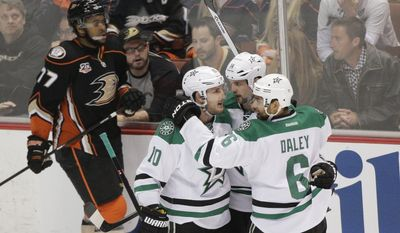 Dallas Stars' Jamie Benn(14) celebrates his goal with Shawn Horcoff (10) and Trevor Daley(6) as Anaheim Ducks' Devante Smith-Pelly(77) skates past them in the first period of Game 5 of the first-round NHL hockey Stanley Cup playoff series on Friday, April 25, 2014, in Anaheim, Calif. (AP Photo/Jae C. Hong)