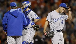 Kansas City Royals relief pitcher Danny Duffy, right, walks off the field after being relieved after loading the bases in the 10th inning of a baseball game against the Baltimore Orioles, Saturday, April 26, 2014, in Baltimore. Baltimore won 3-2 in 10 innings. (AP Photo/Patrick Semansky)