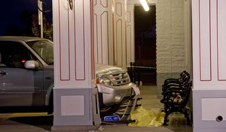 The SUV that was driven by a 70-year-old man still sits at the spot in front of Farrell's Ice Cream Parlour in Buena Park, Calif. where one woman was fatally injured and six others received moderate to minor injuries. The people were waiting to enter the restaurant around 6 p.m. PDT Friday April 25, 2014 when the accident occurred Friday. (AP Photo/The Orange County Register, Paul Rodriguez)