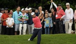In this photo released by OneAsia, Alexander Levy of France watches his shot during the third round of the Volvo China Open at Genzon Golf Club in Shenzhen, southern China, Saturday, April 26, 2014. (AP Photo/OneAsia, Paul Lakatos) NO LICENSING