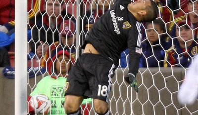 Real Salt Lake goalkeeper Nick Rimando makes a save during an MLS soccer game against the Vancouver Whitecaps in Sandy, Utah, on Saturday, April 26, 2014. (AP Photo/Deseret News, Kristin Murphy) SALT LAKE TRIBUNE OUT  MAGS OUT  MANDATORY CREDIT