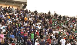 ADVANCE FOR USE SUNDAY, APRIL 27 - In this photo taken on Aug. 31, 2012, fans fill the stadium for the Harvest Bowl high school football game between Wahpeton and Breckenridge in Wahpeton, N.D. Wahpeton, N.D., and Breckenridge, Minn., High Schools have a long-standing tradition of meeting up each season for a hard-nosed game of football. But now this late-August, early-September classic is in jeopardy. (AP Photo/The Daily News)