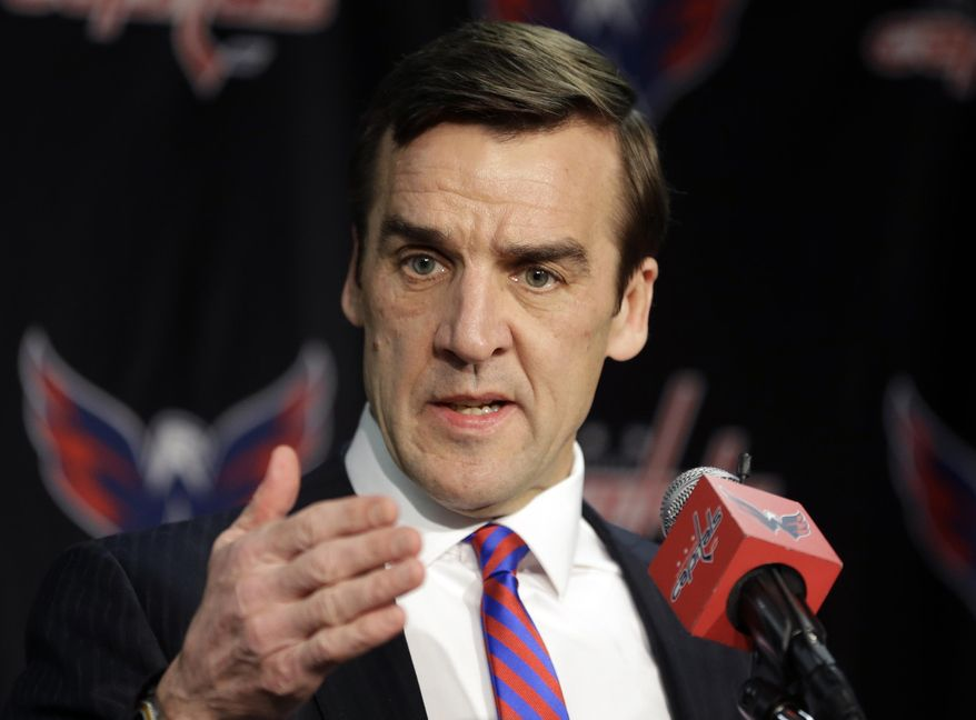 FILE - In this March 8, 2014, file photo, Washington Capitals vice president and general manager George McPhee speaks during a news conference in Washington. Capitals majority owner Ted Leonsis and president Dick Patrick announced Saturday, April 26, 2014, that the Capitals will not renew the contract of McPhee and have relieved head coach Adam Oates of his duties. (AP Photo/Carolyn Kaster, File)