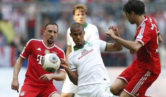 Bremen's Theodor Gebre Selassie of Czech Republic, center, Bayern's Franck Ribery of France, left, and Bayern's Javier Martinez of Spain challenge for the ball during the German first division Bundesliga soccer match between FC Bayern Munich and SV Werder Bremen in Munich, southern Germany, Saturday, April 26, 2014. (AP Photo/Matthias Schrader)