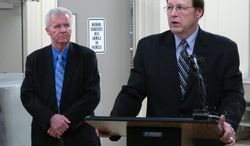 FILE- In this Feb. 28, 2013 file photo, Ohio State Veterinarian Tony Forshey, left, looks on, as David Daniels, Ohio Agriculture Department Director, talks about security at Ohio's new holding facility for animals confiscated under the state's exotic animals ownership ban in Reynoldsburg, Ohio. About one in three owners of exotic animals still lacks a permit more than three months after a state law requiring it went into effect, according to records obtained from the Ohio Department of Agriculture. (AP Photo/Andrew Welsh-Huggins, File)
